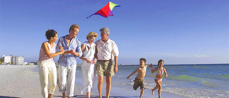 Family-kite-flying-on-beach-at-Tradewinds